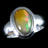silver-and-opal-ring-large-oval-in-thick-casing